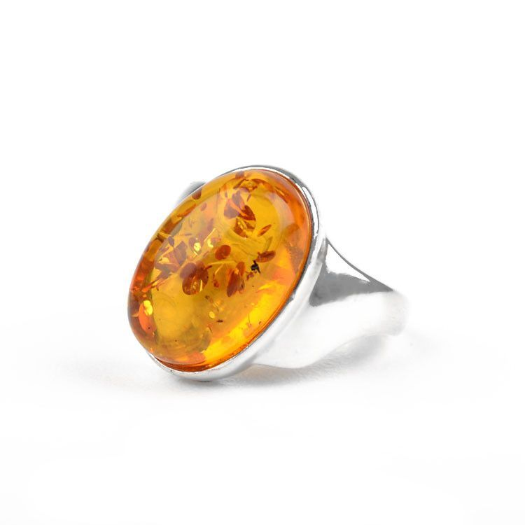 Unique Tilted Oval Amber Ring
