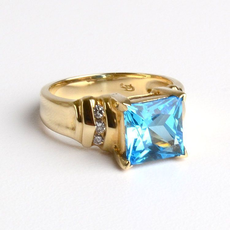 rings topaz gold emerald swiss ring cut gemstone jewellery white image blue